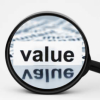 "Magnifying glass zooming in on the word ""value"""